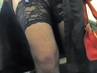 Flashing fishnet stockings on escalator