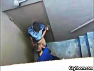 Two gay dudes on the stairwell stop for a quick nasty blowjob