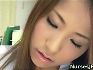 Asian nurse slut gives a handjob