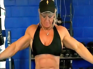 Body builder blonde Maryse Manios shows off her big muscles