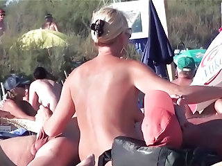 French nudist beach Cap d'Agde woman plays with 2..