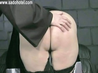 Beautiful nun with her skirt up is bending over and is spanked on her ass by master priest