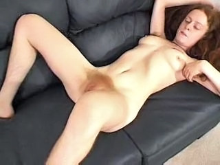 Redhead slut shows her hairy twat