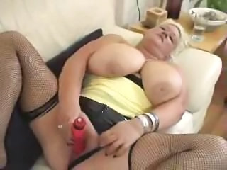 BBW blonde Nicole is giving a closeup view of her masturbating