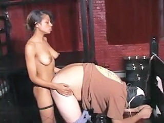 Ebony nympho goddess Carmen puts on a strap-on to administer punishment