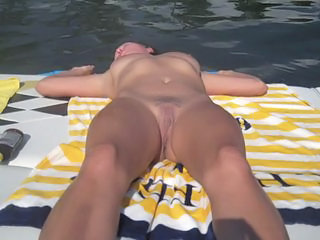 My girlfriend  nude sunbathing on the boat