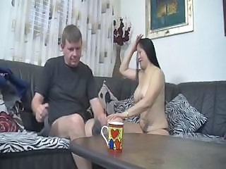 Busty Asian babe sucks on the cock before getting fucked on couch