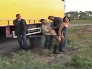 Sophie came with her husband who filmed the scene She wanted to meet some truck drivers on the road She found some of them and asked her to be banged in all holes