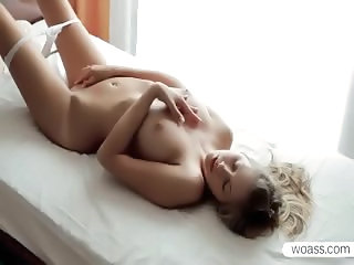Delicate Barbie pleasing her pink wet pussy in bed