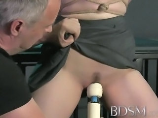 BDSM XXX Black haired sub has breasts tied to the ceiling by her Master...