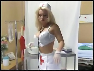 Nurse with fishnet stockings and latex gloves fucking in a hospital bed