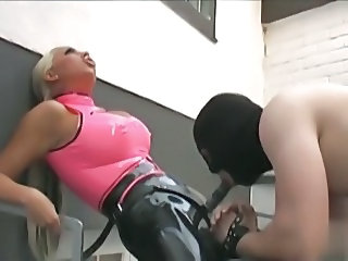 Latex blonde and strapon slave
