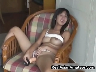 Little Asian Amateur Plugs A Huge Dildo Part2