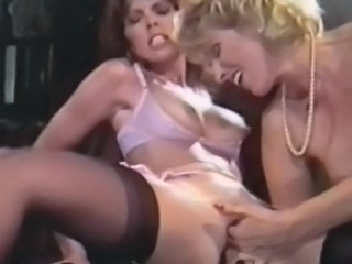 Classic babe Janey Robbins enjoys a lesbian affair with Patty Manning. These...