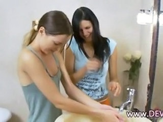 Coed girls dildoing holes in the bath tube together