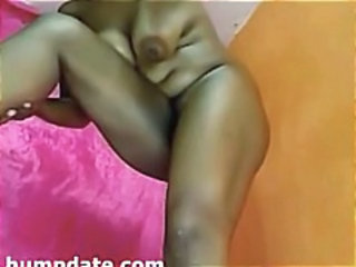 Horny BBW ebony fists her pussy and then uses toys on it on cam