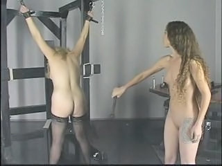 Chubby bitch in bondage gets tortured by brunette