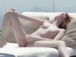 Pleasing redhead opening vagina outside