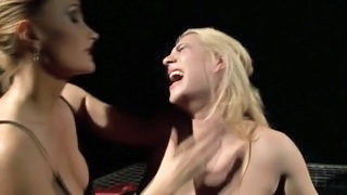 Chained Down Slut Gets Smacked Around By Dominatrix