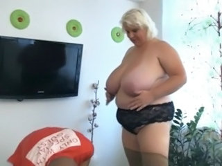 Large blonde gives the titjob