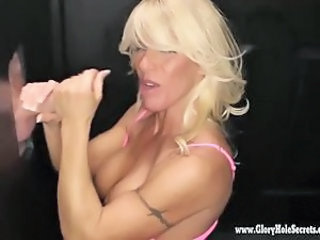 Blonde fitness babe loves to suck cock at the Gloryhole