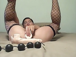 Asian with anal beads and dildo