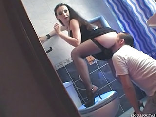 Brunette Licking Stockings Toilet