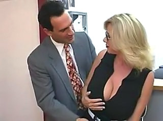 Mature secretary gets cum atop her big tits
