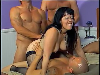MILF in nylons takes insusceptible to 3 big cocks