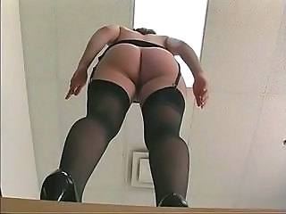 Frisky office slut in stockings gets fucked wits long dildo