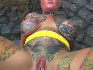 Big Tits Fetish Piercing Tattoo
