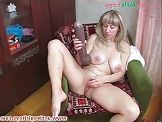 Old lady has solo sex with a socking toy tubes