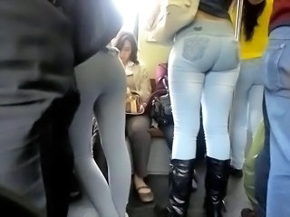 Asses two girls on slay rub elbows with subway Brazil