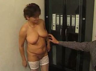 Granny in White Stockings Fucks in the Office