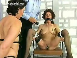 Slave with great body and ball is spanked on her pussy and her pussy lips electroshocked by police officer