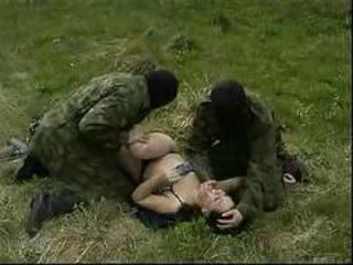 Young brunette abused in the forest by guys in masks