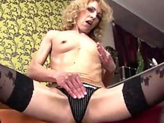 Slim granny in black stockings gets her cunt fist