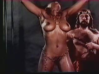 Maledom:  Big Titted Harem Girl Receives A Whipping (in slow motion)