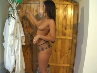 Sexy brunette doctor masturbates hard at work