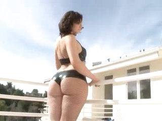 Curvy redhead in leather lingerie teases outdoors