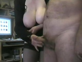 Fat mature in black stockings jacks his cock
