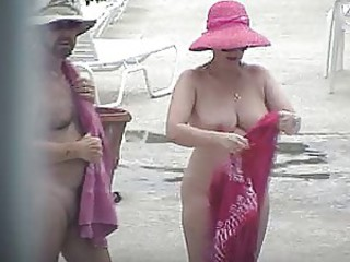 Nude Lady showering outside