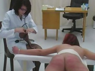 Two young women are caned by a doctor