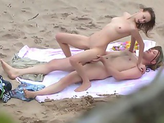 Amateur couple making love at nude beach