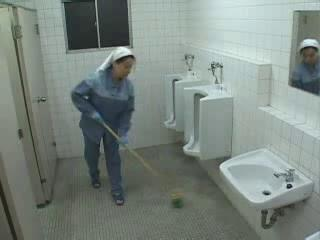 Asian Nurse And Cleaning Lady Help A Patient Jerk Of...