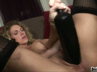 Luscious Roxanne Hall shoves her dildo in her snatch