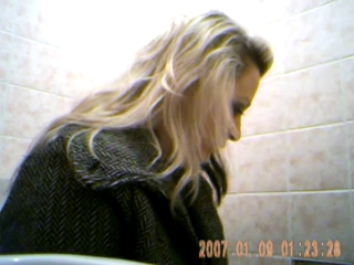 Adorable young girl spied on toilet 1