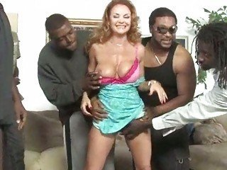 Eight blacks sharing busty MILF Janet Mason