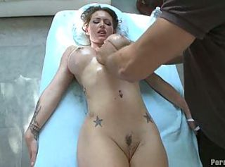 Busty chick gets a oiled pussy massage