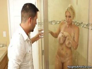 Blonde milf fucks in bathroom and takes facials